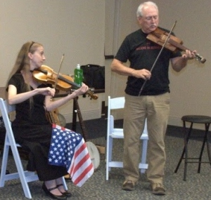Two fiddle styles making music together.